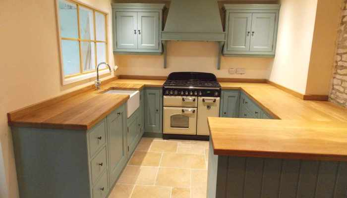 Fitted kitchen, painted shaker cabinets with solid wood countertop, belfast sink and aga cooker