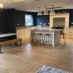 Kitchen floor cupboards on natural timber floor